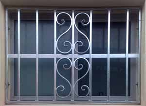 Photo of a custom made window grille with scroll effect
