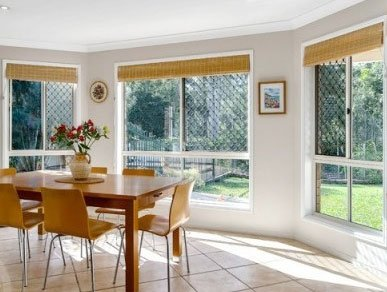Dining room with bamboo blinds fitted