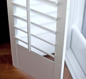 Close up of white plantation bi-fold shutter slats detail