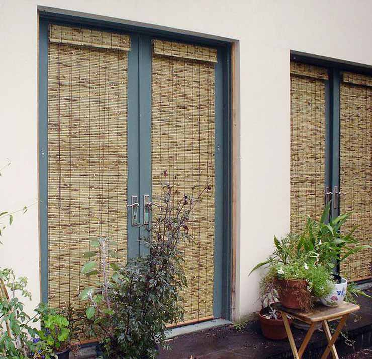 Photo of External Bamboo Blinds shading external french doors.