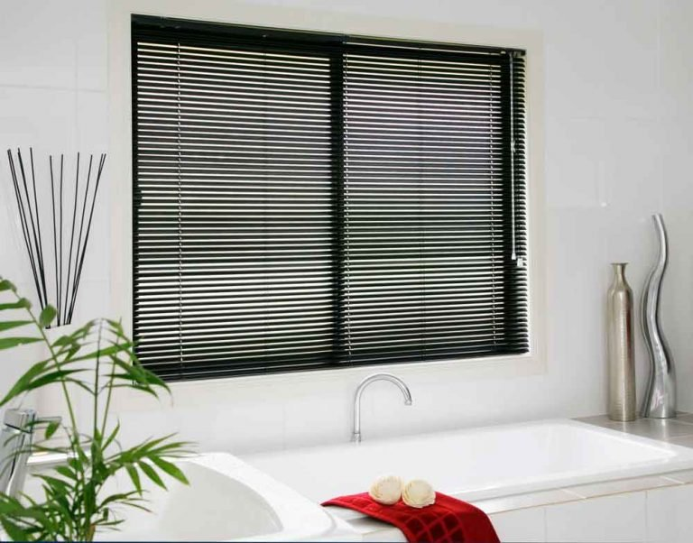 Black Venetian blind fitted to a bathroom window