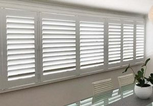 Hinged Shutter fitted to a wide window