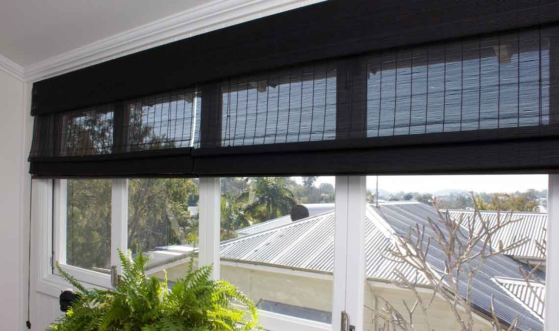 Black matchstick window blind in a period home